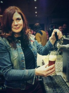 N17 founder Sarah Roarty pours a pint at a craft beer exhibit in Dublin.